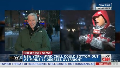 Anchor Jason Carroll reports from Columbia University's Low Plaza while Anderson Cooper chuckles at the scene.