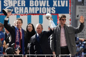 Andrew Cuomo, Michael Bloomberg and others celebrate the New York Giants 2012 win. (Photo: Andrew Burton/Getty)