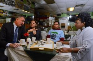 Bill de Blasio and Melissa Mark-Viverito, along with two paid sick day advocates, at the restaurant used for today's event. (Photo: Mayor's office/Twitter)