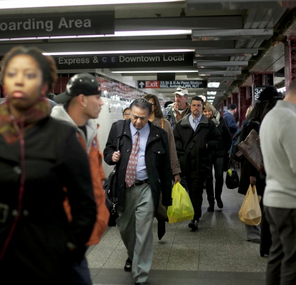 Commuters at Penn Station. (Photo by Allison Joyce/Getty Images)