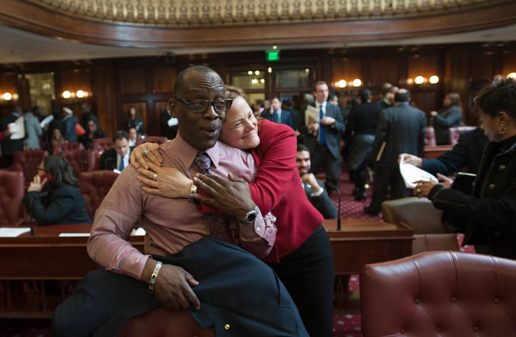 Speaker Melissa Mark-Viverito hugs Councilman Daneek Miller. (Photo: William Alatriste/NYC Council)
