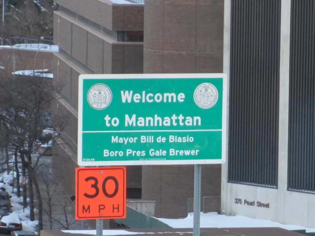 """A new """"Welcome to Manhattan"""" sign."""