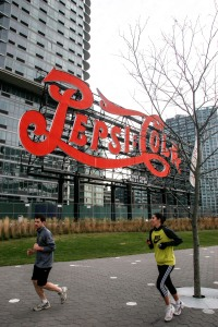 TF Cornerstone's residential towers rise behind the Pepsi-Cola sign. (Amanda Perez, The New York Observer.)