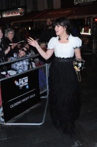Ms. Allen acknowledging humans at a movie premiere. (Photo: Getty)
