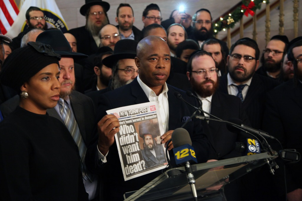 Brooklyn Borough President Eric Adams  holds up a copy of the New York Post at today's protest. (Photo: Kathryn Kirk)