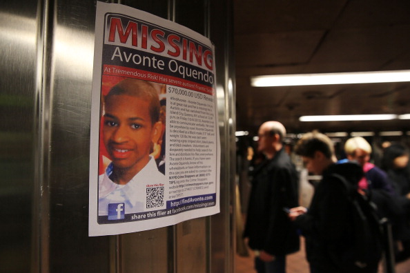 A missing person's photo depicts Avonde Oquendo. (Photo: Spencer Platt/Getty Images)