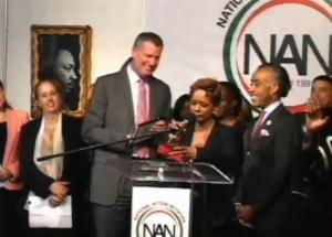Rachel Noerdlinger speaking at National Action Network headquarters.