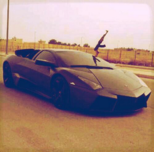 Yep—that's a rifle sticking out of a Lamborghini. (Twitter)