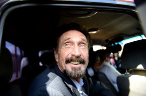 John McAfee probably smiled like this at the exciting news. (Getty)