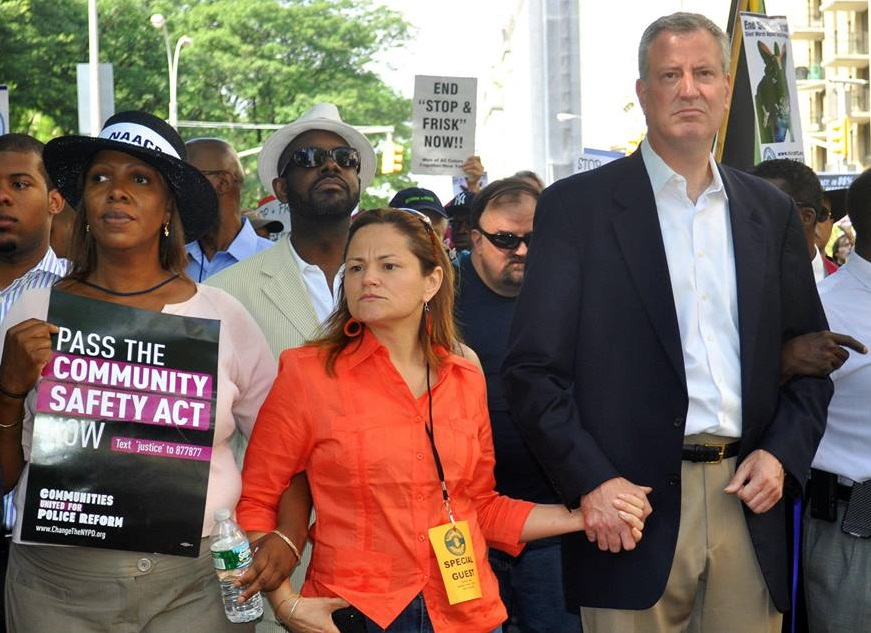 Public Advocate Tish James, Council Speaker Melissa Mark-Viverito and Mayor Bill de Blasio march together, arms interlocked. (Photo: Facebook)