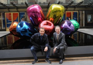 Gorvy with Jeff Koons and a record-setting work by the artist that sold at Christie's. (Courtesy Getty Images)