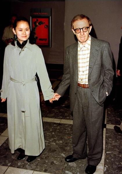 "LOS ANGELES, UNITED STATES:  Actor-director Woody Allen (R) and his adopted daughter and girlfriend, Soon Yi Previn arrive for the world premiere of his new film, ""Deconstructing Harry"" 05 December in Los Angeles. The film stars, among others, Mariel Hemingway, Demi Moore and Elisabeth Shue and opens in the United States 12 December. (Vince Bucci/AFP/Getty Images)"