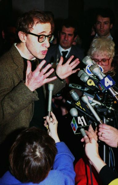 NEW YORK, NY - DECEMBER 16:  U.S. Actor-Director Woody Allen (L) speaks to reporters in New York, NY after a pre-trial hearing 15 December, 1992 on the custody fight between Allen and former girlfriend Mia Farrow. Farrow's lawyers are asking that Allen not be allowed to contact his adopted daughter Dylan and not seek custody when his wife dies.  (Photo credit should read HAI DO/AFP/Getty Images)