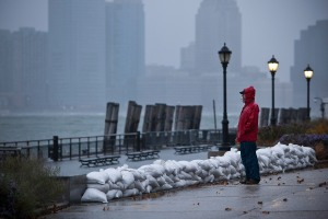 A man watches the waves in New York Harbor from Battery Park during the arrival of Hurricane Sandy. (Photo via Getty Images)