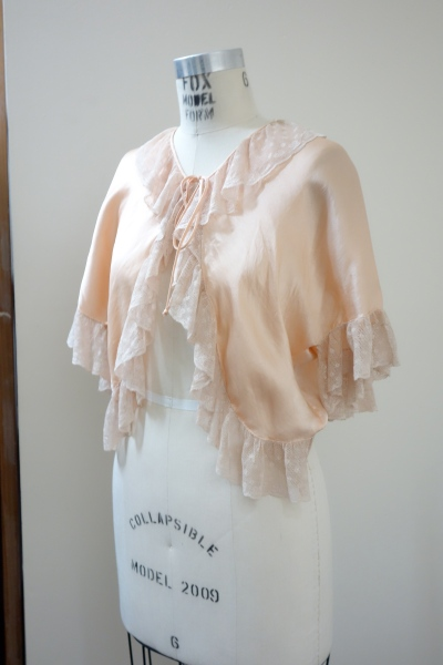 This bed jacket dates back to the 1930's.