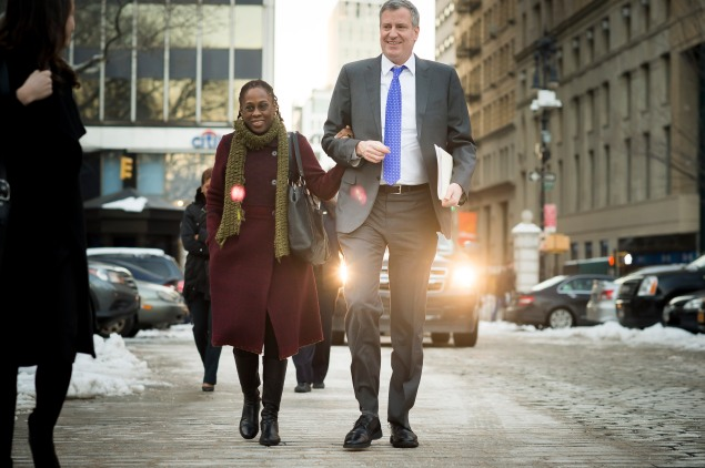 Bill de Blasio walking down the street with his wife, Chirlane McCray. (Photo: Rob Bennett/NYC Mayor's Office)
