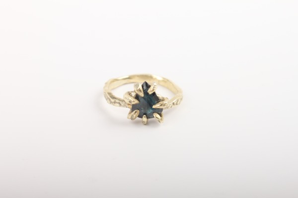 Consider inky, less traditional engagement rings.