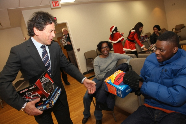 CareOne CEO Daniel Straus hands out holiday presents at Beth Israel Hospital in Newark, NJ.