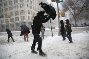 A man attempts to brave the snow in Manhattan Thursday. (Photo: John Moore/Getty)