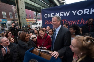 Mayor Bill de Blasio and Council Speaker Melissa Mark-Viverito at a press conference announcing the agreement of a new paid sick days bill. (Photo: NYC Council)
