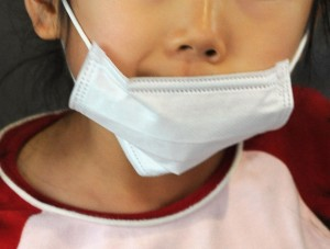 An young Japanese girl wears a face mask
