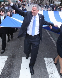 Bill de Blasio marches in a parade yesterday. (Photo: Rob Bennett/NYC Mayor's Office)