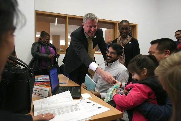Mayor Bill de Blasio visits a pre-K enrollment workshop in Brooklyn earlier this month. (Photo: Rob Bennett/NYC Mayor's Office)