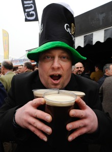 A man holds some Guiness during some St. Patrick's Day celebrations. (Photo: Alan Crowhurst/Getty)