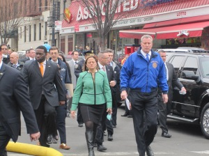Mayor Bill de Blasio and emergency responders a block from the scene of the explosion.