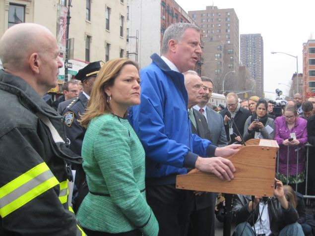 Speaker Melissa Mark-Viverito, standing beside the mayor at a briefing.