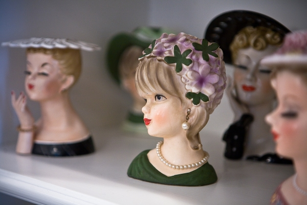 A collection of antique lady head vases. (Photo by Emily Anne Epstein)