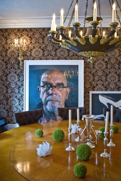 A Chuck Close self-portrait leans against the wall of the dining room. Photo by Emily Anne Epstein.