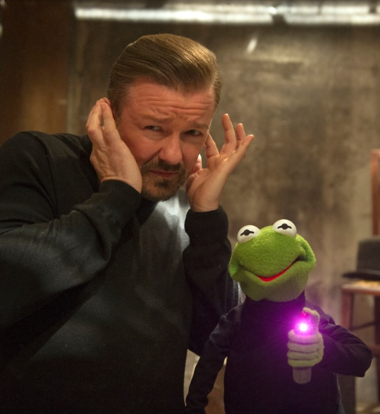 Ricky Gervais, as Dominic Badguy, alongside a Kermit impersonator in Muppets Most Wanted.