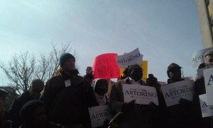 """Protesters wave signs like """"Astori-NO!"""" behind Mr. Astorino as he speaks."""