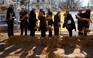 Jonathan Rose, fourth from left, breaking ground.