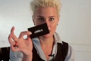 Ms. Cheeks and a Cheek'd card (Screengrab: YouTube)