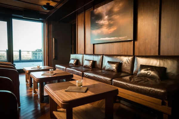Leather couches and wood interiors lend a vaguely nautical air.