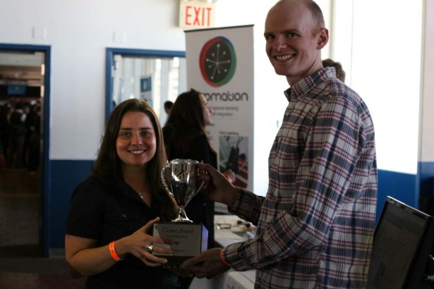 Marina Teper and Andrew Martin of EnergyHub won a trophy from New York Attorney General Eric Schneiderman.