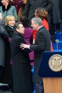 Mayor Bill de Blasio appears to know how Gov. Andrew Cuomo prefers his hugs here. (Photo: Flickr/N.Y. Governor's Office)