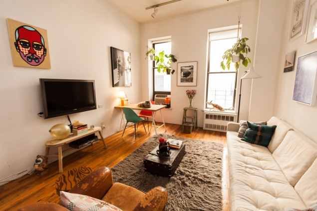The living room, featuring a portrait by Craig Redman. (Photo by Emily Assiran)