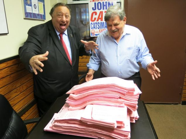 2013 mayoral candidate John Catsimatidis marveling at his petition stacks last year. (Photo: Twitter/@JCats2013)