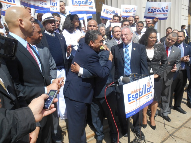 State Senator Adriano Espaillat embraces the Bronx Democratic chairman as Bronx Borough President Rubén Díaz, Jr. looks on (right).