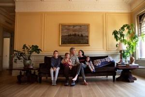 The Sheers at home in their ballroom turned living room. (Celeste Solomon/the Observer.)