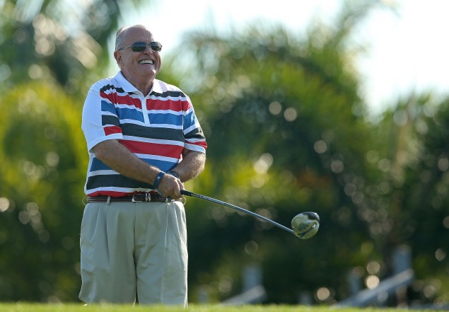 Rudy Giuliani takes a swing. (Photo: Mike Ehrmann/Getty)