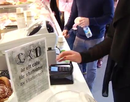 A shopper uses the system. (Screengrab via YouTube)