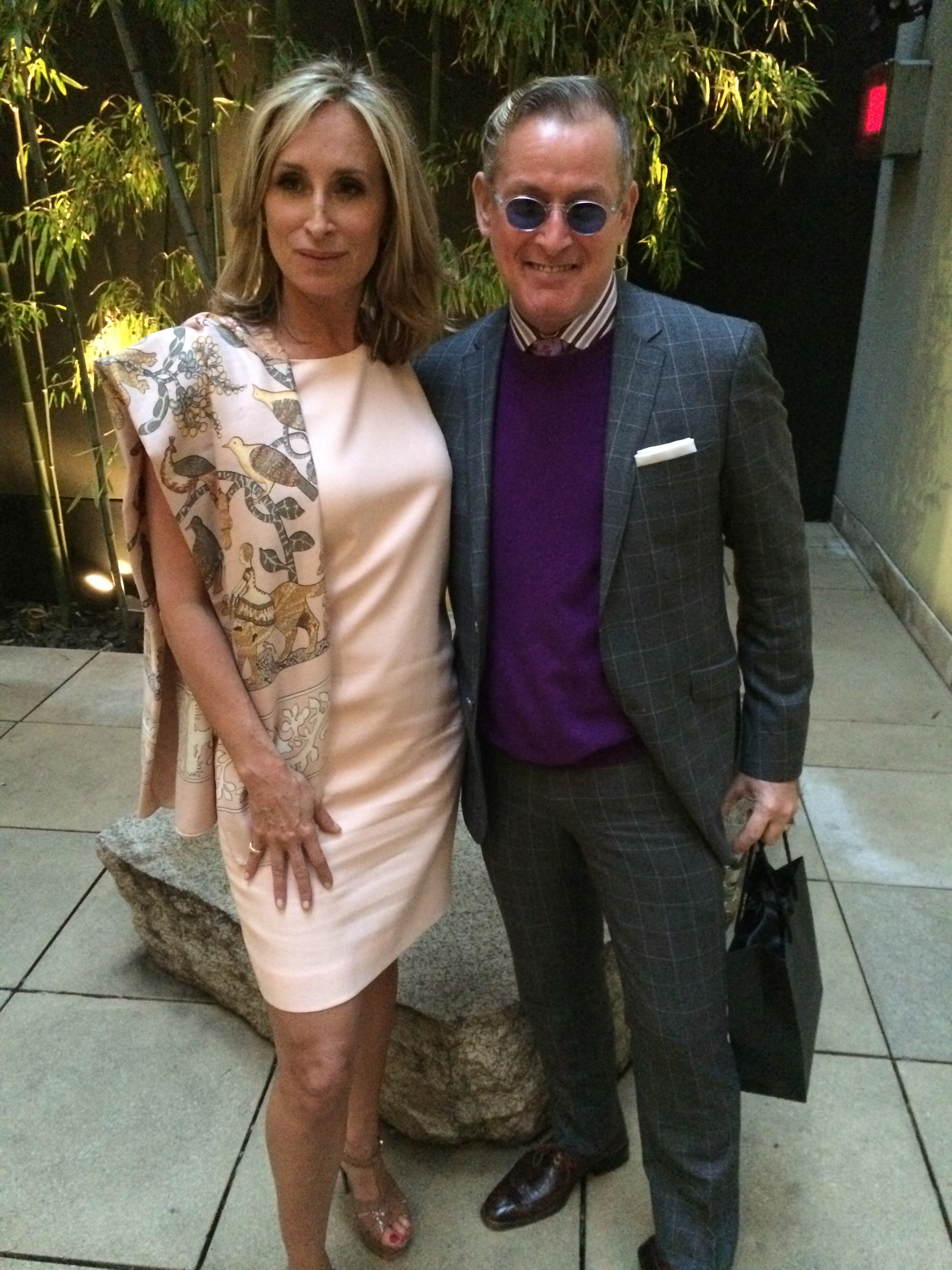 Ms. Morgan and Mr. Frazier in the courtyard at Donna Karan's Madison Avenue boutique.