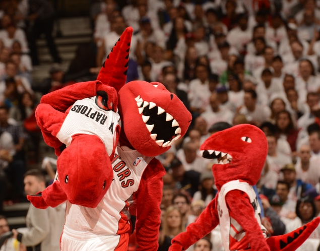The Toronto Raptors mascots perform during Game One of the Eastern Conference Quarterfinals of the 2014 NBA playoffs against the Brooklyn Nets on April 10 (Photo by Ron Turenne/NBAE via Getty)