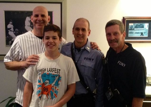 The author Harlan Coben with his son and two FDNY good samaritans. (Getty Images)