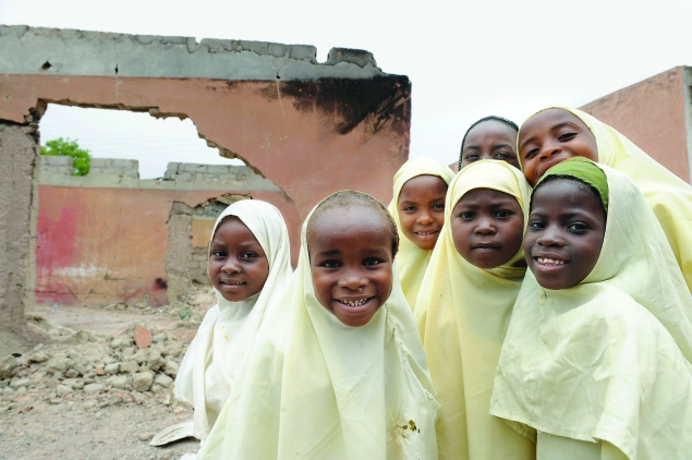 Young girls outside a school in Nigeria, where the militant anti-education group Boko Haram has kidnapped girls and vowed to sell them into slavery.