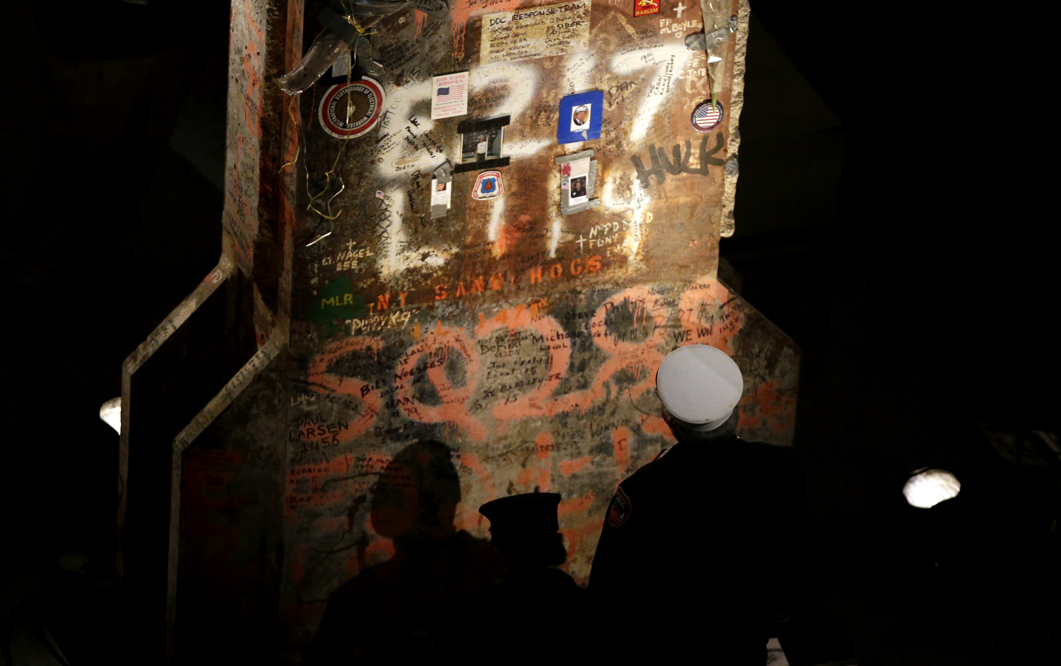 An FDNY fireman looks at the last column recovered at the World Trade Center (John Munson-Pool/Getty Images)